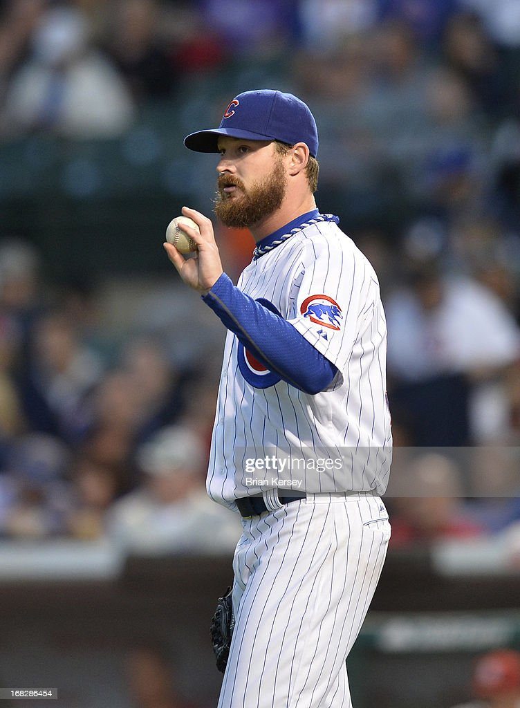 Starting pitcher <a gi-track='captionPersonalityLinkClicked' href=/galleries/search?phrase=Travis+Wood&family=editorial&specificpeople=805314 ng-click='$event.stopPropagation()'>Travis Wood</a> #37 of the Chicago Cubs stands on the mound during the third inning against the St. Louis Cardinals on May 7, 2013 at Wrigley Field in Chicago, Illinois. The Cubs defeated the Cardinals 2-1.