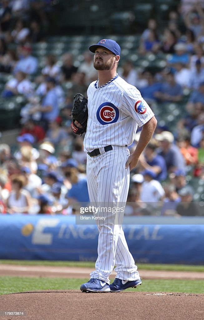 Starting pitcher <a gi-track='captionPersonalityLinkClicked' href=/galleries/search?phrase=Travis+Wood&family=editorial&specificpeople=805314 ng-click='$event.stopPropagation()'>Travis Wood</a> #37 of the Chicago Cubs stands on the mound after giving up a solo home run to Christian Yelich #21 of the Miami Marlins during the first inning at Wrigley Field on September 2, 2013 in Chicago, Illinois.