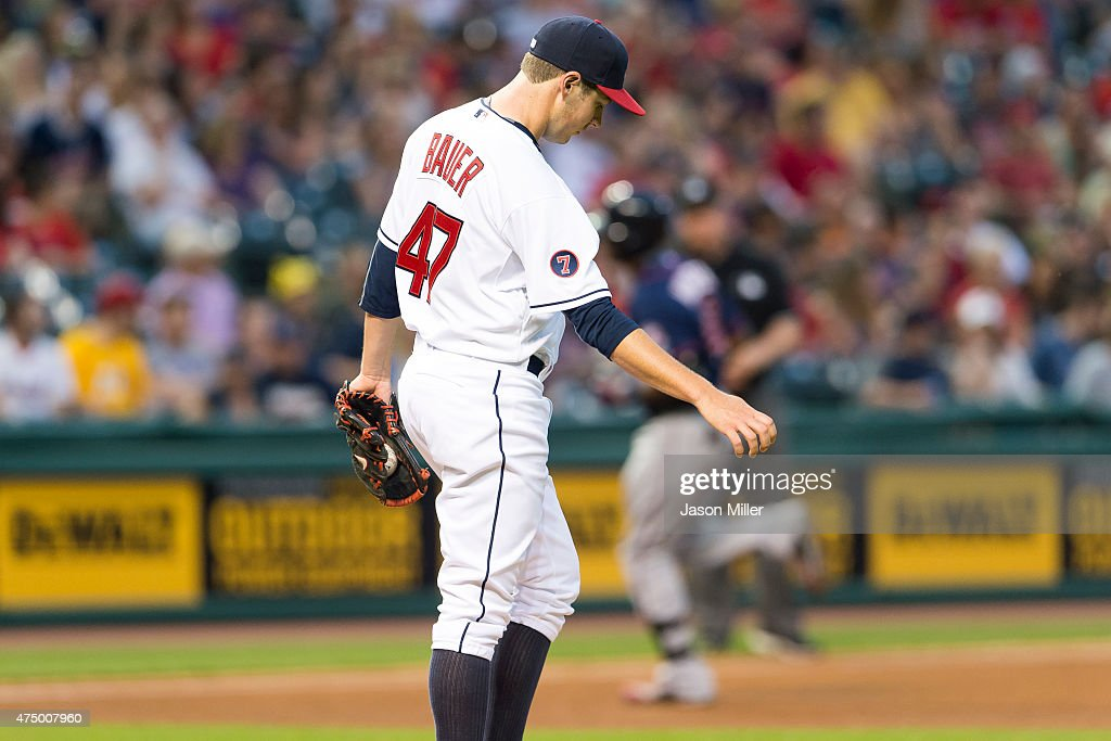 Starting pitcher <a gi-track='captionPersonalityLinkClicked' href=/galleries/search?phrase=Trevor+Bauer+-+Baseball+Player&family=editorial&specificpeople=11364936 ng-click='$event.stopPropagation()'>Trevor Bauer</a> #47 of the Cleveland Indians reacts after giving up a home run to <a gi-track='captionPersonalityLinkClicked' href=/galleries/search?phrase=Torii+Hunter&family=editorial&specificpeople=183408 ng-click='$event.stopPropagation()'>Torii Hunter</a> #48 of the Minnesota Twins during the fifth inning at Progressive Field on May 8, 2015 in Cleveland, Ohio.