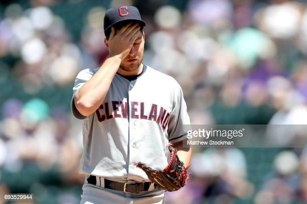 Starting pitcher Trevor Bauer of the Cleveland Indians wipes his face between pitches in the first inning against the Colorado Rockies at Coors Field...