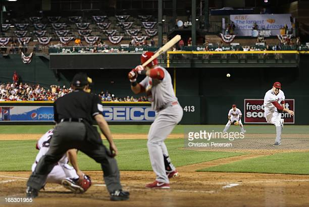 Starting pitcher Trevor Cahill of the Arizona Diamondbacks pitches against Carlos Beltran of the St Louis Cardinals during the MLB game at Chase...