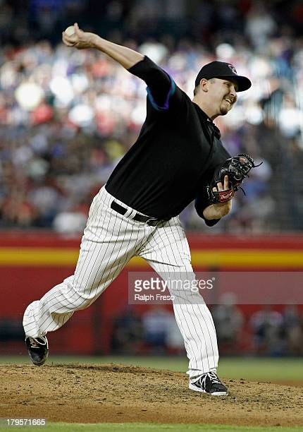 Starting pitcher Trevor Cahill of the Arizona Diamondbacks pitches against the San Francisco Giants during the second inning of a MLB game at Chase...