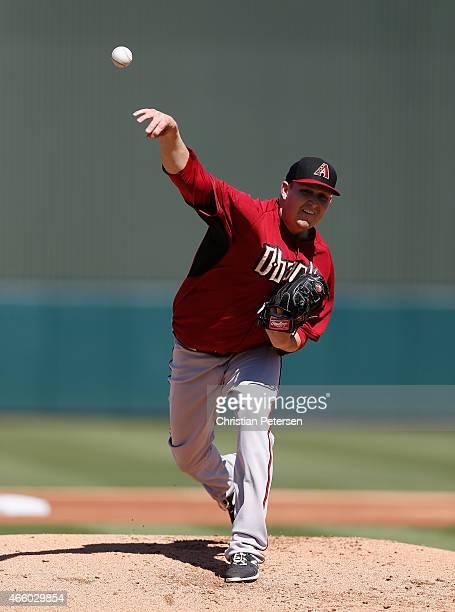 Starting pitcher Trevor Cahill of the Arizona Diamondbacks pitches against the Oakland Athletics during the spring training game at HoHoKam Stadium...