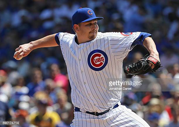Starting pitcher Trevor Cahill of the Chicago Cubs delivers the ball against the Milwaukee Brewers at Wrigley Field on August 16 2016 in Chicago...