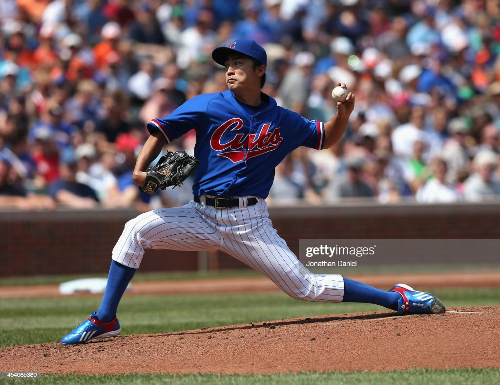 Starting pitcher <a gi-track='captionPersonalityLinkClicked' href=/galleries/search?phrase=Tsuyoshi+Wada&family=editorial&specificpeople=2943743 ng-click='$event.stopPropagation()'>Tsuyoshi Wada</a> #67 of the Chicago Cubs delivers the ball against the Baltimore Orioles at Wrigley Field on August 24, 2014 in Chicago, Illinois.