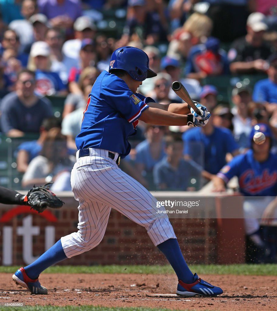 Starting pitcher <a gi-track='captionPersonalityLinkClicked' href=/galleries/search?phrase=Tsuyoshi+Wada&family=editorial&specificpeople=2943743 ng-click='$event.stopPropagation()'>Tsuyoshi Wada</a> #67 of the Chicago Cubs hits a single in the 3rd inning against the Baltimore Orioles at Wrigley Field on August 24, 2014 in Chicago, Illinois.