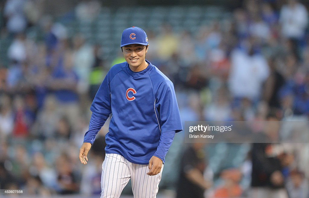 Starting pitcher <a gi-track='captionPersonalityLinkClicked' href=/galleries/search?phrase=Tsuyoshi+Wada&family=editorial&specificpeople=2943743 ng-click='$event.stopPropagation()'>Tsuyoshi Wada</a> #67 of the Chicago Cubs smiles after defeating the San Francisco Giants in a resumed game at Wrigley Field on August 21, 2014 in Chicago, Illinois. The game was initially called off in the early morning hours of August 20 over a protest from the Giants. Major League Baseball accepted the Giants' appeal, ruling the delay was caused by a mechanical failure of the tarp and changing the status of the game from cancelled and completed with a Cubs 2-0 win to a suspended game. The Cubs defeated the Giants 2-1.