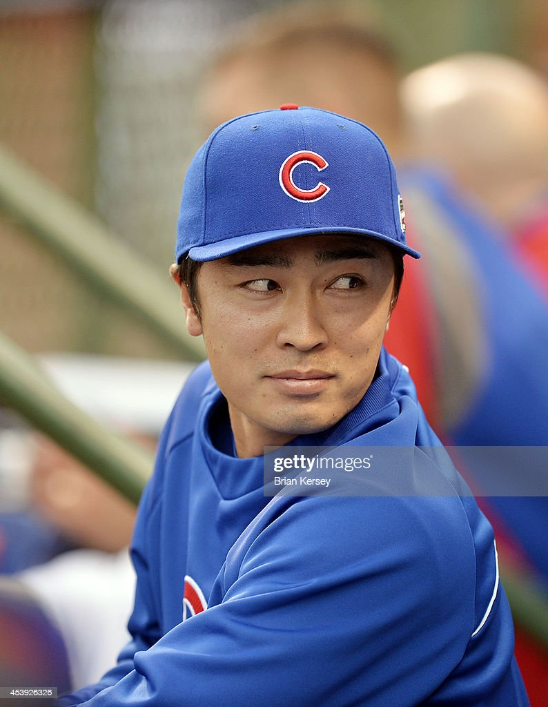 Starting pitcher <a gi-track='captionPersonalityLinkClicked' href=/galleries/search?phrase=Tsuyoshi+Wada&family=editorial&specificpeople=2943743 ng-click='$event.stopPropagation()'>Tsuyoshi Wada</a> #67 of the Chicago Cubs stands in the dugout during the fifth inning of a resumed game against the San Francisco Giants at Wrigley Field on August 21, 2014 in Chicago, Illinois. Wada had started the August 19th game that was initially called off in the early morning hours of August 20 under a protest from the Giants. Major League Baseball accepted the Giants' appeal, ruling the delay was caused by a mechanical failure of the tarp and changing the status of the game from cancelled and completed with a Cubs 2-0 win to a suspended game.