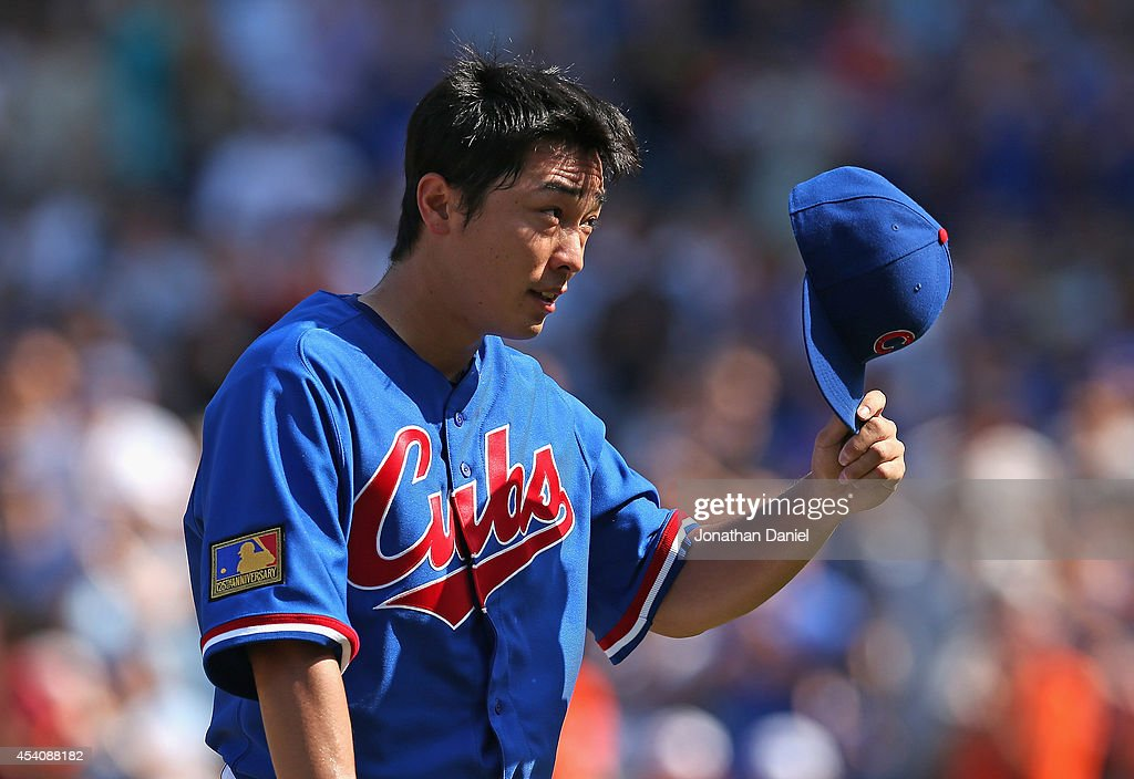 Starting pitcher <a gi-track='captionPersonalityLinkClicked' href=/galleries/search?phrase=Tsuyoshi+Wada&family=editorial&specificpeople=2943743 ng-click='$event.stopPropagation()'>Tsuyoshi Wada</a> #67 of the Chicago Cubs tips his hat to the crowd after being taken out of a game against the Baltimore Orioles in the 7th inning at Wrigley Field on August 24, 2014 in Chicago, Illinois.