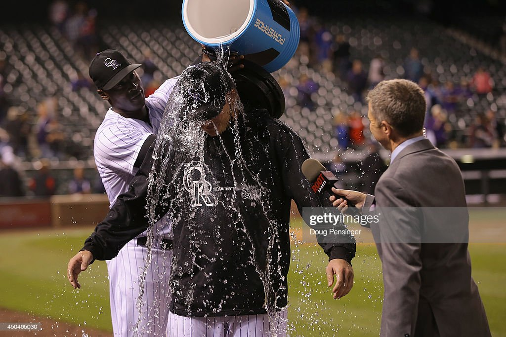 Starting pitcher Tyler Matzek of the Colorado Rockies is doused by LaTroy Hawkins of the Colorado Rockies after Matzek earned a win in his Major...