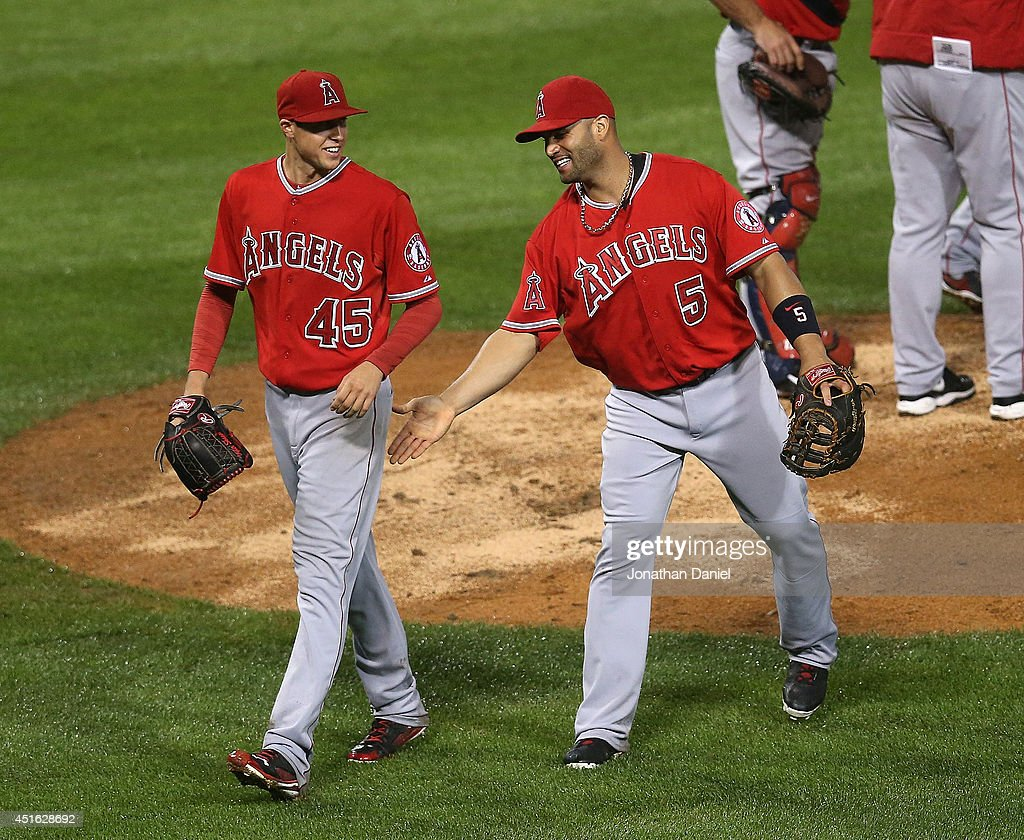 Starting pitcher Tyler Skaggs #45 of the Los Angeles Angels of Anaheim gets a pat from Albert Pujols #5 after being taken out of the game against the Chicago White Sox in the 8th inning at U.S. Cellular Field on July 2, 2014 in Chicago, Illinois.