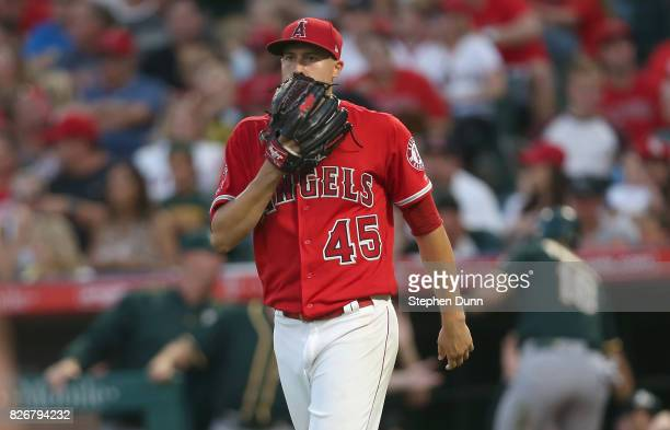 Starting pitcher Tyler Skaggs of the Los Angeles Angels of Anaheim reacts after giving up a two run single in the fourth inning to Dustin Garneau of...