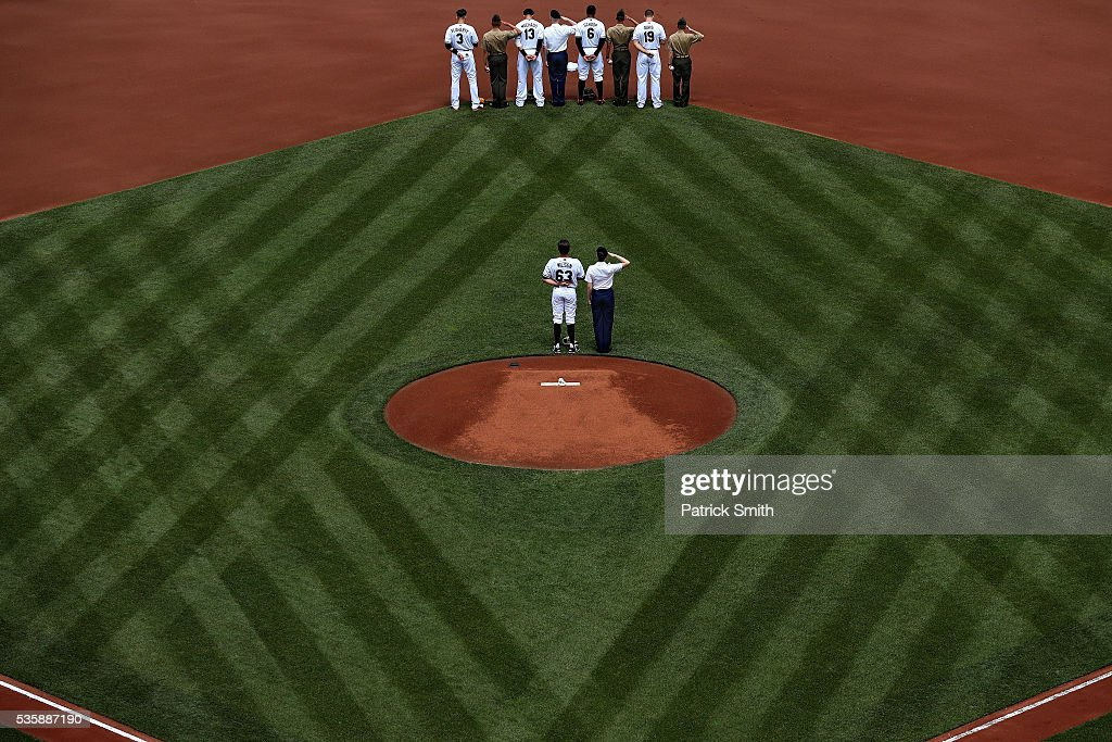 Starting pitcher <a gi-track='captionPersonalityLinkClicked' href=/galleries/search?phrase=Tyler+Wilson+-+Baseball+Player&family=editorial&specificpeople=14638083 ng-click='$event.stopPropagation()'>Tyler Wilson</a> #63 of the Baltimore Orioles and teammates stand with members of the United States Armed Forces before playing against the Boston Red Sox at Oriole Park at Camden Yards on May 30, 2016 in Baltimore, Maryland.