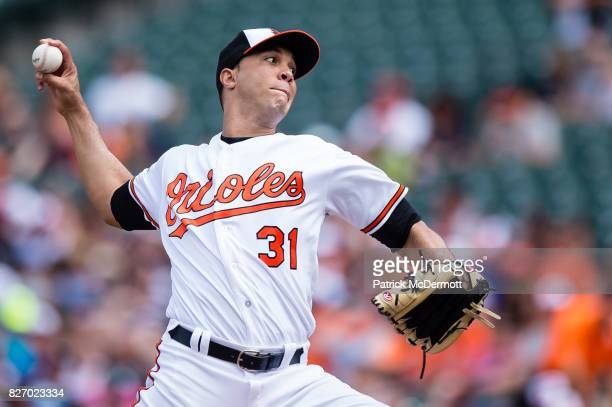 Starting pitcher Ubaldo Jimenez of the Baltimore Orioles throws a pitch to a Detroit Tigers batter in the first inning during a game at Oriole Park...