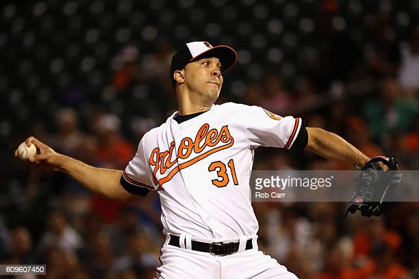 Starting pitcher Ubaldo Jimenez of the Baltimore Orioles throws to a Boston Red Sox batter in the first inning at Oriole Park at Camden Yards on...