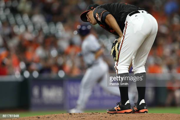 Starting pitcher Ubaldo Jimenez of the Baltimore Orioles watches runs scores after Wilson Ramos of the Tampa Bay Rays hit a grand slam home run...