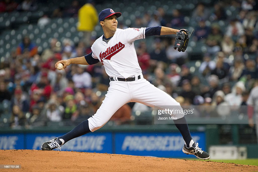 Starting pitcher <a gi-track='captionPersonalityLinkClicked' href=/galleries/search?phrase=Ubaldo+Jimenez&family=editorial&specificpeople=2539590 ng-click='$event.stopPropagation()'>Ubaldo Jimenez</a> of the Cleveland Indians pitches during the second inning against the Boston Red Sox at Progressive Field on April 16, 2013 in Cleveland, Ohio. All uniformed team members are wearing jersey number 42 in honor of Jackie Robinson Day.