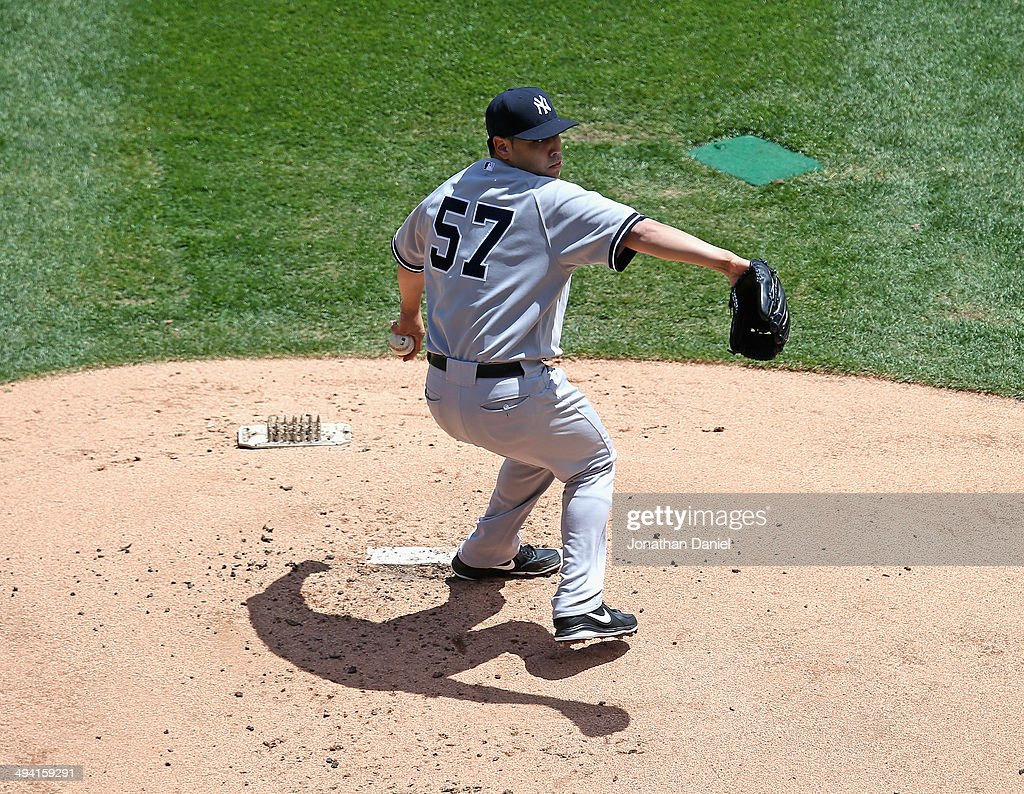 Starting pitcher Vidal Nuno #57 of the New York Yankees delivers the ball against the Chicago White Sox at U.S. Cellular Field on May 24, 2014 in Chicago, Illinois.