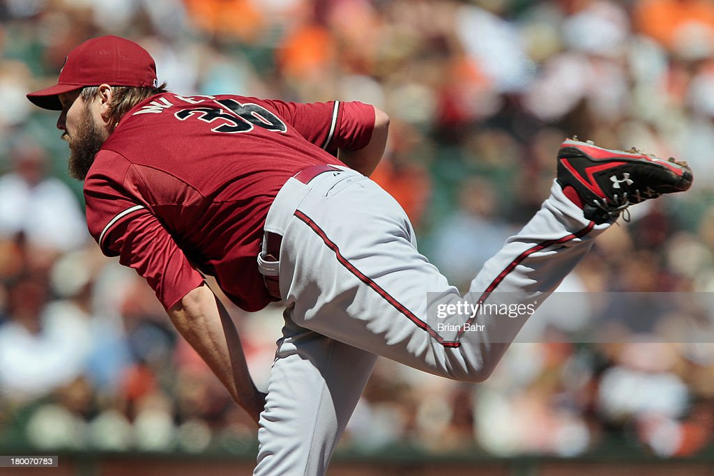 Starting pitcher <a gi-track='captionPersonalityLinkClicked' href=/galleries/search?phrase=Wade+Miley&family=editorial&specificpeople=7511054 ng-click='$event.stopPropagation()'>Wade Miley</a> #36 of the Arizona Diamondbacks delivers a pitch against the San Francisco Giants in the first inning at AT&T Park on September 8, 2013 in San Francisco, California.