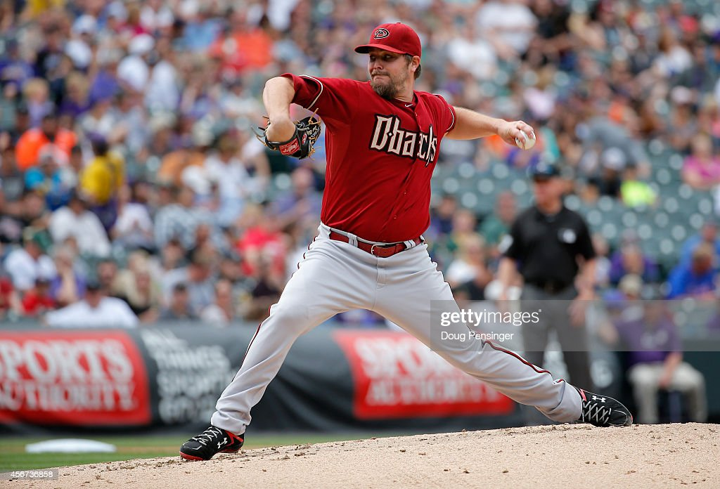 Starting pitcher Wade Miley of the Arizona Diamondbacks delivers against the Colorado Rockies at Coors Field on September 21 2014 in Denver Colorado...