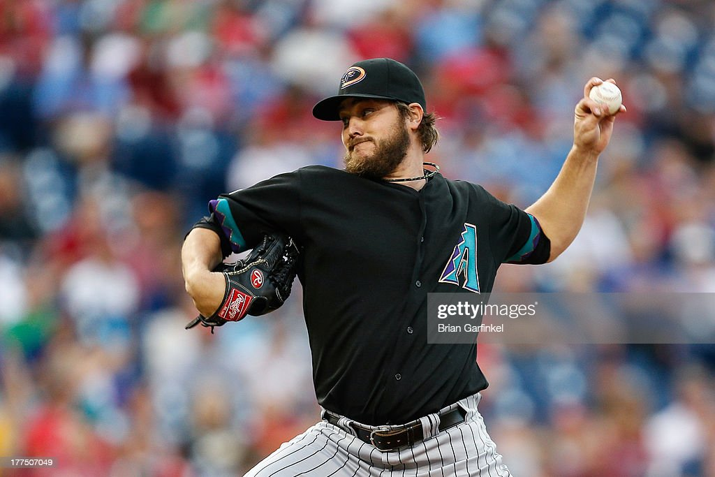 Starting pitcher <a gi-track='captionPersonalityLinkClicked' href=/galleries/search?phrase=Wade+Miley&family=editorial&specificpeople=7511054 ng-click='$event.stopPropagation()'>Wade Miley</a> #36 of the Arizona Diamondbacks throws a pitch during the game against the Philadelphia Phillies at Citizens Bank Park on August 23, 2013 in Philadelphia, Pennsylvania.