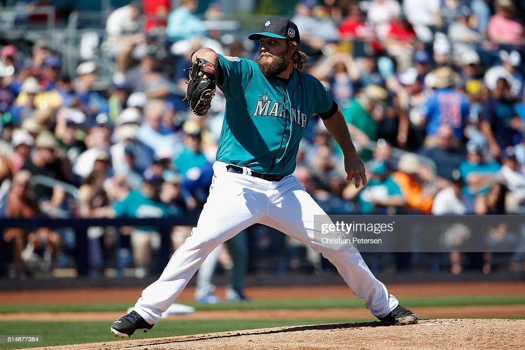 Starting pitcher Wade Miley of the Seattle Mariners pitches against the Chicago Cubs during the first innnig of the spring training game at Peoria...