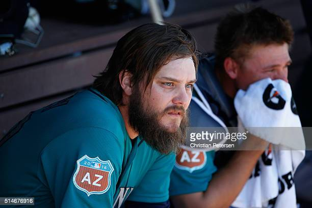 Starting pitcher Wade Miley of the Seattle Mariners sits in the dugout before the spring training game against the Chicago Cubs at Peoria Stadium on...
