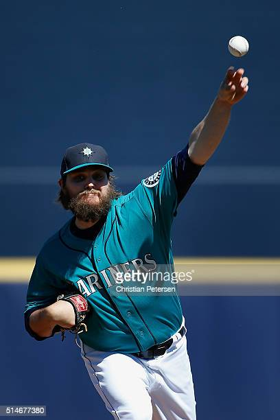 Starting pitcher Wade Miley of the Seattle Mariners throws a warm up pitch during the frist inning of the spring training game against the Chicago...