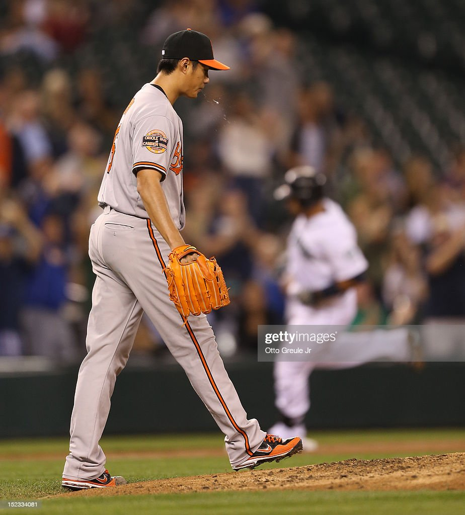 Starting pitcher <a gi-track='captionPersonalityLinkClicked' href=/galleries/search?phrase=Wei-Yin+Chen&family=editorial&specificpeople=8958243 ng-click='$event.stopPropagation()'>Wei-Yin Chen</a> #16 of the Baltimore Orioles looks down at the mound after giving up a two-run homer to Miguel Olivo #30 of the Seattle Mariners at Safeco Field on September 18, 2012 in Seattle, Washington.