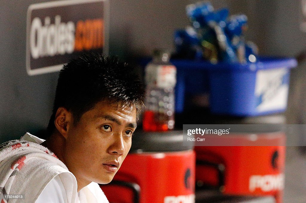 Starting pitcher Wei-Yin Chen #16 of the Baltimore Orioles looks on from the dugout during the sixth inning of the Orioles 6-1 win over the Texas Rangers at Oriole Park at Camden Yards on July 10, 2013 in Baltimore, Maryland.