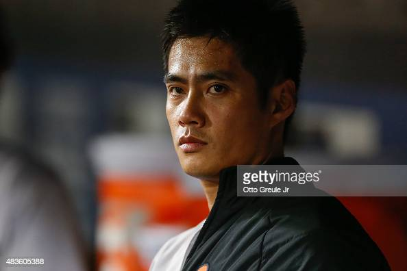 Starting pitcher WeiYin Chen of the Baltimore Orioles looks on from the dugout in the eighth inning against the Seattle Mariners at Safeco Field on...