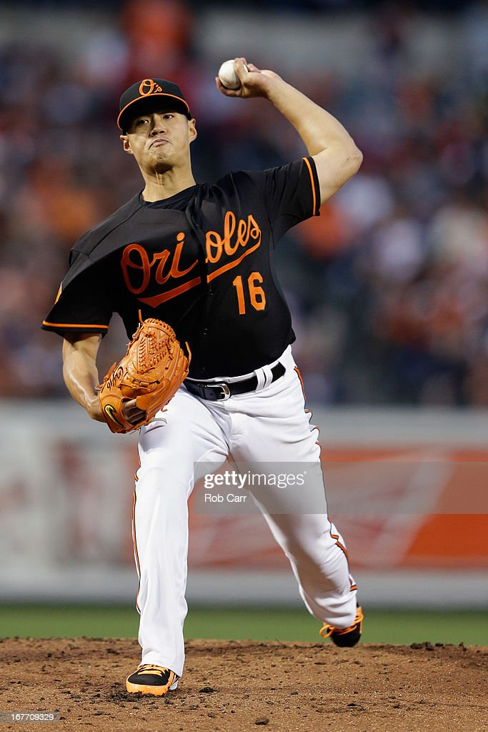 Starting pitcher <a gi-track='captionPersonalityLinkClicked' href=/galleries/search?phrase=Wei-Yin+Chen&family=editorial&specificpeople=8958243 ng-click='$event.stopPropagation()'>Wei-Yin Chen</a> #16 of the Baltimore Orioles throws to a Los Angeles Dodgers batter in the second inning of game two of a double header at Oriole Park at Camden Yards on April 20, 2013 in Baltimore, Maryland.