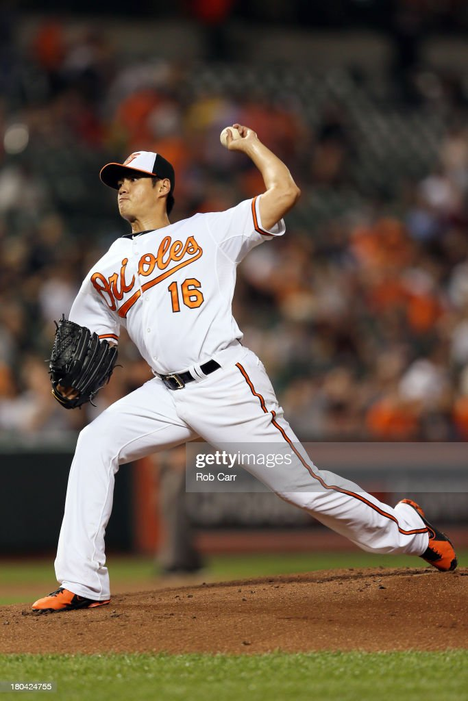 Starting pitcher Wei-Yin Chen #16 of the Baltimore Orioles throws to a New York Yankees batter during the first inning at Oriole Park at Camden Yards on September 12, 2013 in Baltimore, Maryland.
