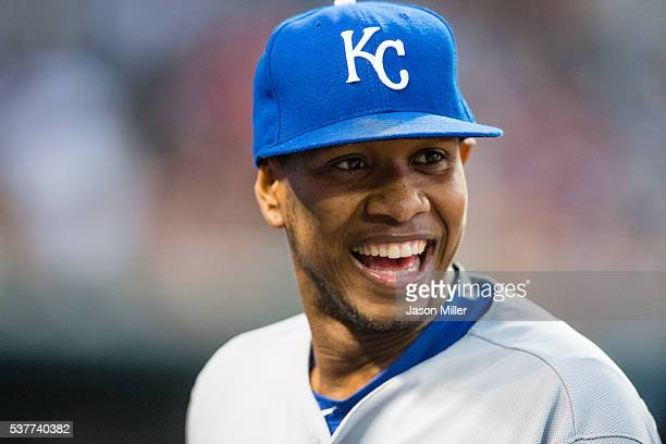 Starting pitcher Yordano Ventura of the Kansas City Royals jokes with teammates as he walks off the field after the fifth inning against the...