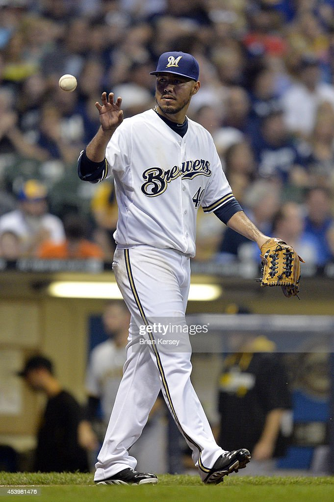 Starting pitcher <a gi-track='captionPersonalityLinkClicked' href=/galleries/search?phrase=Yovani+Gallardo&family=editorial&specificpeople=757367 ng-click='$event.stopPropagation()'>Yovani Gallardo</a> #49 of the Milwaukee Brewers gets the ball back during the third inning against the Pittsburgh Pirates at Miller Park on August 22, 2014 in Milwaukee, Wisconsin.