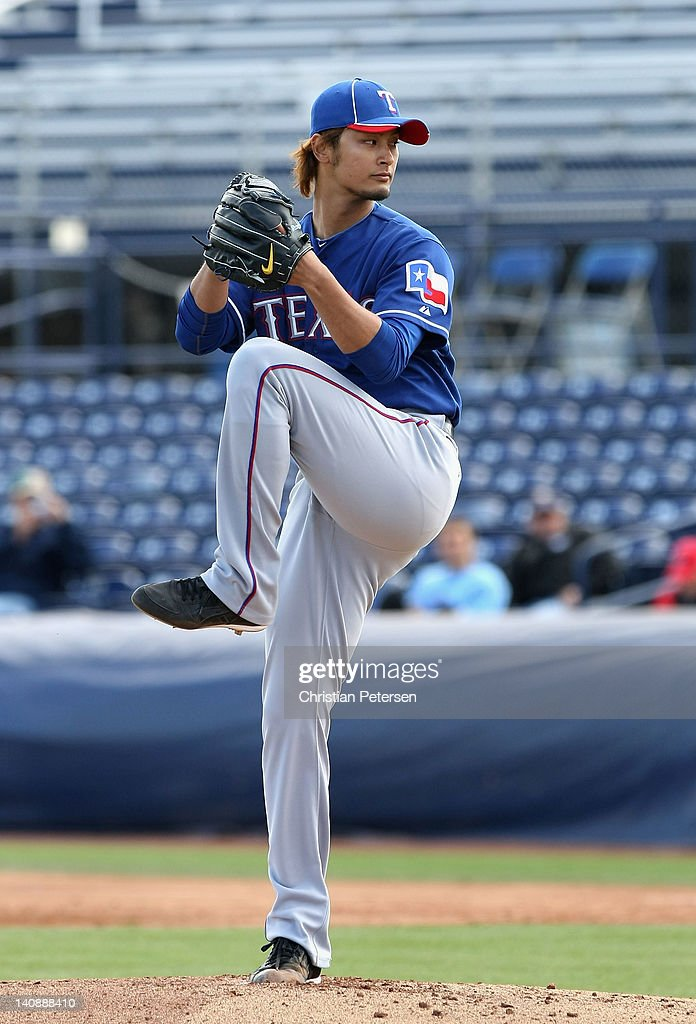 Starting pitcher <a gi-track='captionPersonalityLinkClicked' href=/galleries/search?phrase=Yu+Darvish&family=editorial&specificpeople=4018539 ng-click='$event.stopPropagation()'>Yu Darvish</a> #11 of the Texas Rangers pitches against the San Diego Padres during the spring training game at Peoria Stadium on March 7, 2012 in Peoria, Arizona.