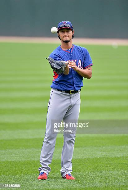 Starting pitcher Yu Darvish of the Texas Rangers plays catch lefthanded during batting practice before the game against the Chicago White Sox at US...