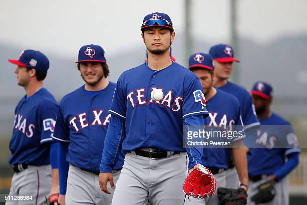 Starting pitcher Yu Darvish of the Texas Rangers practices during a spring training workout at Surprise Stadium on February 19 2016 in Surprise...