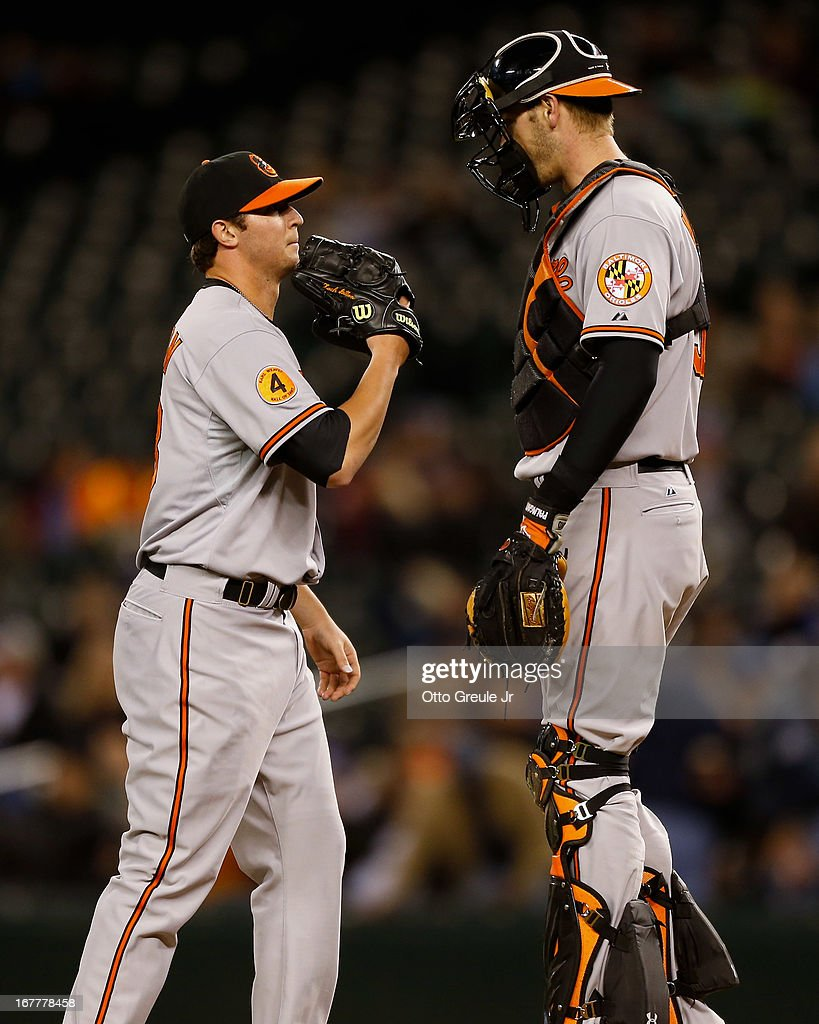 Starting pitcher Zach Britton #53 (L) of the Baltimore Orioles talks with catcher Matt Wieters #32 after giving up an RBI single to Robert Andino of the Seattle Mariners in the fourth inning at Safeco Field on April 29, 2013 in Seattle, Washington. The Mariners defeated the Orioles 6-2.