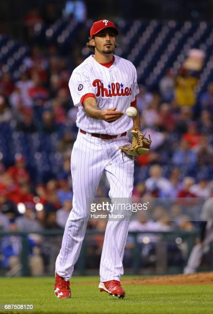 Starting pitcher Zach Eflin of the Philadelphia Phillies tosses to first base after fielding a bunt in the fourth inning during a game against the...