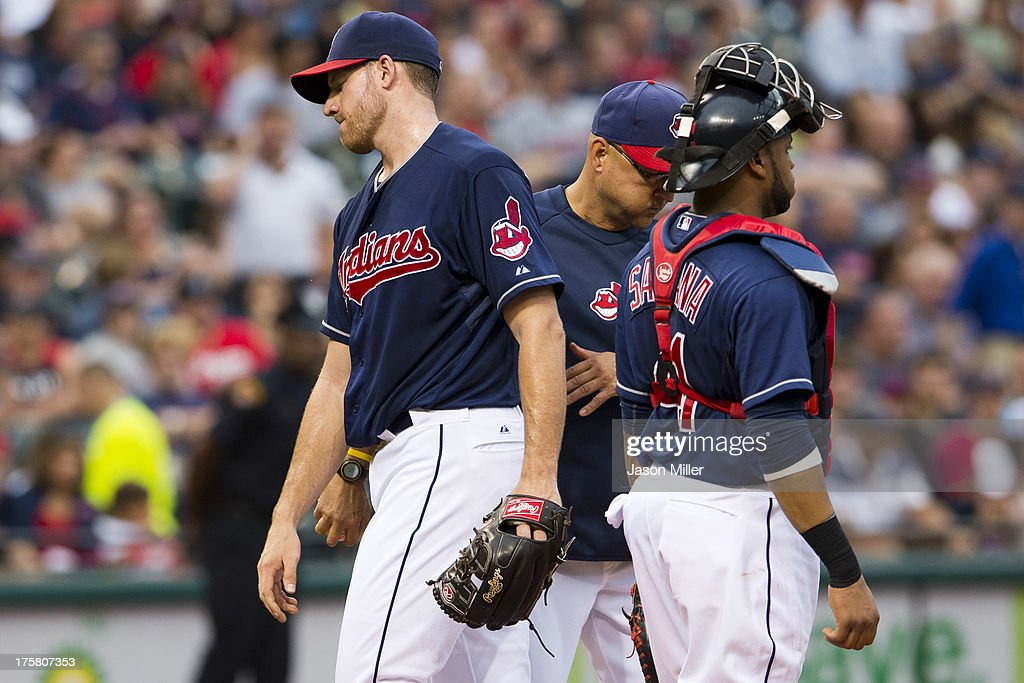 Starting pitcher <a gi-track='captionPersonalityLinkClicked' href=/galleries/search?phrase=Zach+McAllister&family=editorial&specificpeople=6816291 ng-click='$event.stopPropagation()'>Zach McAllister</a> #34 of the Cleveland Indians leaves the game after giving up five runs during the third inning against the Detroit Tigers at Progressive Field on August 8, 2013 in Cleveland, Ohio.