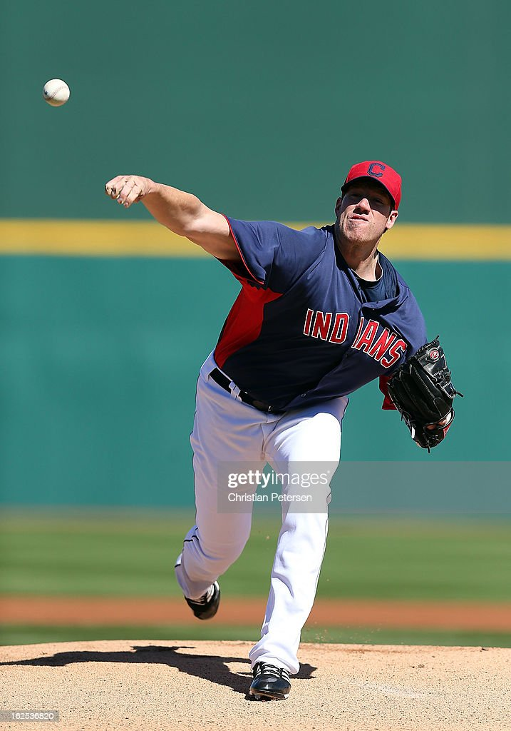 Starting pitcher <a gi-track='captionPersonalityLinkClicked' href=/galleries/search?phrase=Zach+McAllister&family=editorial&specificpeople=6816291 ng-click='$event.stopPropagation()'>Zach McAllister</a> #34 of the Cleveland Indians pitches against the Cincinnati Reds during the spring training game at Goodyear Ballpark on February 24, 2013 in Goodyear, Arizona