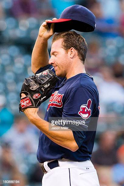 Starting pitcher Zach McAllister of the Cleveland Indians reacts after giving up a run during the second inning against the Oakland Athletics at...