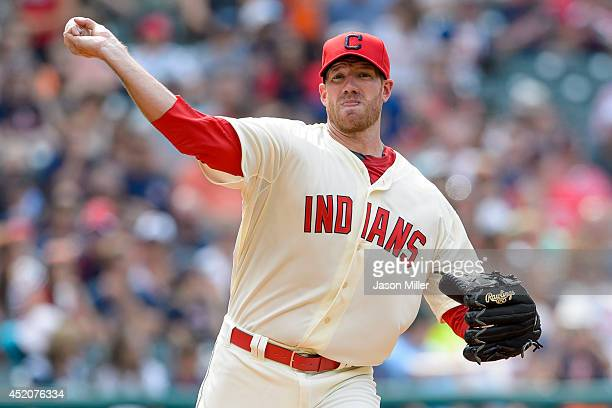 Starting pitcher Zach McAllister of the Cleveland Indians throws to first for a pickoff attempt during the sixth inning against the Chicago White Sox...
