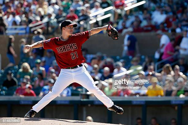Starting pitcher Zack Greinke of the Arizona Diamondbacks pitches against the Oakland Athletics during the first inning of the spring training game...