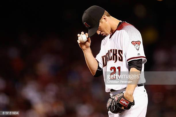 Starting pitcher Zack Greinke of the Arizona Diamondbacks prepares to pitch against the Colorado Rockies during the second inning of the MLB opening...