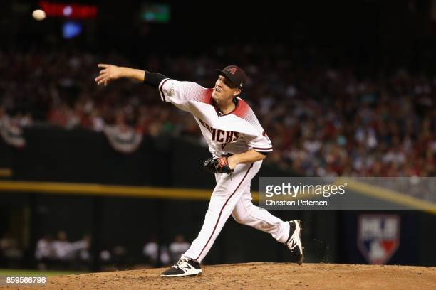 Starting pitcher Zack Greinke of the Arizona Diamondbacks throws during the third inning of the National League Divisional Series game three against...
