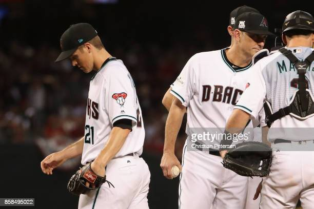 Starting pitcher Zack Greinke of the Arizona Diamondbacks walks off the field after being removed from the game during the fourth inning of the...