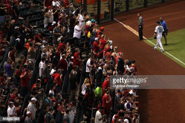 Starting pitcher Zack Greinke of the Arizona Diamondbacks walks out to the bullpen before the National League Wild Card game against the Colorado...