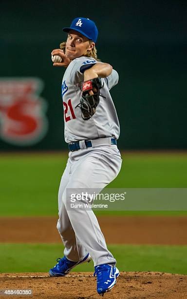 Starting pitcher Zack Greinke of the Los Angeles Dodgers warms up in the first inning during a MLB game against the Arizona Diamondbacks on September...